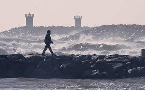 Picture waves, sea, rocks, man, walking, seagulls, troubled sea