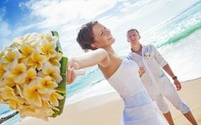 Picture sea, beach, bouquet, a couple in love