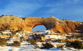 Picture the sky, snow, rock, arch