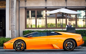 Picture orange, the building, people, Roadster, lamborghini, drives, murcielago, roadster, orange, rims, Lamborghini, building, murciélago