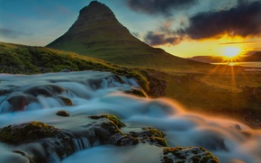 Picture the sun, rays, river, stones, dawn, mountain, waterfall