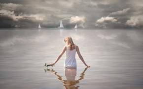 Picture girl, flowers, sails, in the water