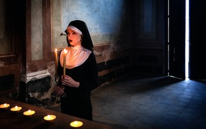 Picture candles, nun, prayer