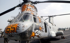 Picture the deck of the ship, bright colors, Combat helicopter