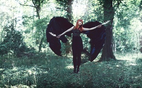 Picture wings, feathers, the red-haired girl