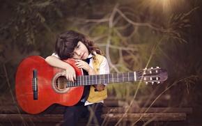 Picture guitar, boy, Dina Telhami, Saleh