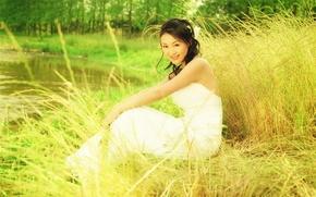 Picture summer, pond, brunette, ears, white dress