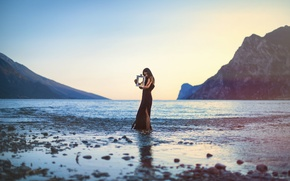Picture beach, the sky, girl, sunset, mountains, reflection, hair, lamp, Bay, black dress