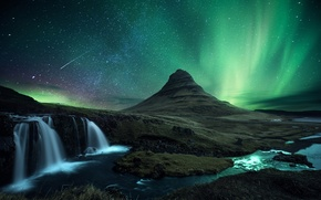 Picture the volcano, mountain, Kirkjufell, snow, waterfall, meteor, Northern lights, comet, night, Iceland, rocks, stars