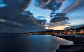 Picture sea, beach, the sky, the city, the evening