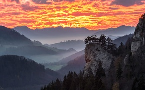 Picture the sky, clouds, trees, mountains, fog, house, rocks, valley, glow