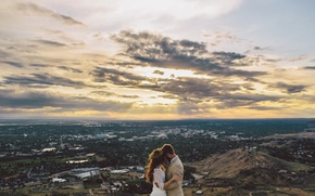 Picture the sky, clouds, the city, lovers, the bride, wreath, the groom