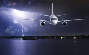 Picture sea, the storm, flight, night, clouds, lights, glare, the plane, rain, coast, zipper, passenger, airliner