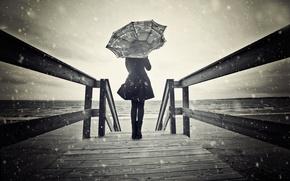 Picture girl, snow, the wind, umbrella