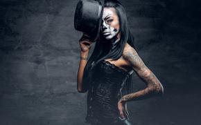 Picture woman, tattoos, makeup, hatter, day of the dead