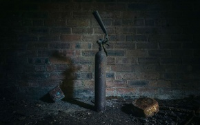 Picture rust, brick wall, a fire extinguisher