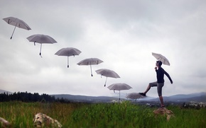 Picture stage, umbrellas, guy