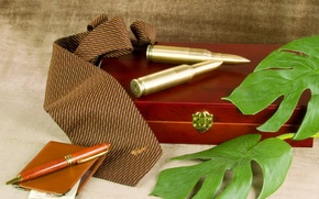 Picture handle, tie, box, cartridges, background., wallet