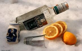 Picture lemon, bottle, orange, glass, salt, tequila.Olmeca