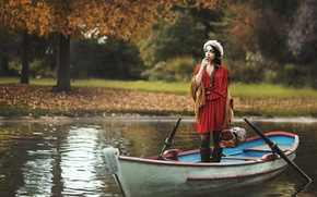 Picture girl, boat, suitcase