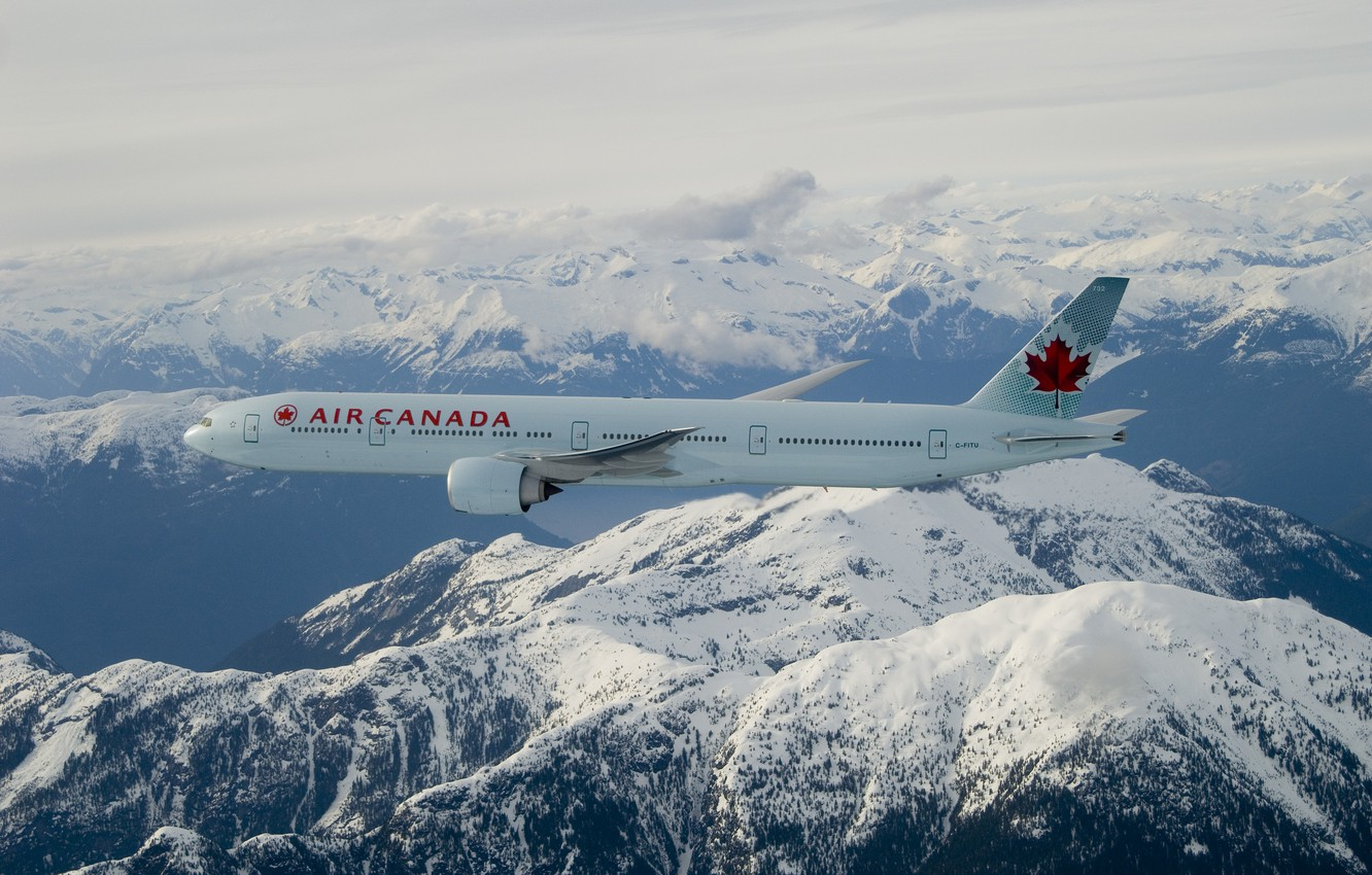 Photo wallpaper clouds, snow, flight, mountains, Boeing, maple leaf, Air Canada, 777-300ER