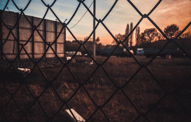 Photo wallpaper sadness, the sun, sunset, yellow, the city, garbage, mesh, dark, the fence, dark