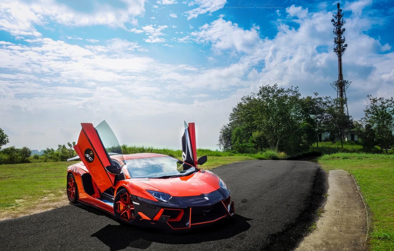 Photo wallpaper road, the sky, clouds, trees, orange, lawn, lamborghini, front view, orange, Lamborghini, aventador, DMC aventador, …