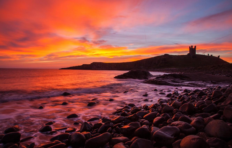 Photo wallpaper sea, stones, shore, England, silhouette, glow, Northumberland, castle Dunstanburgh