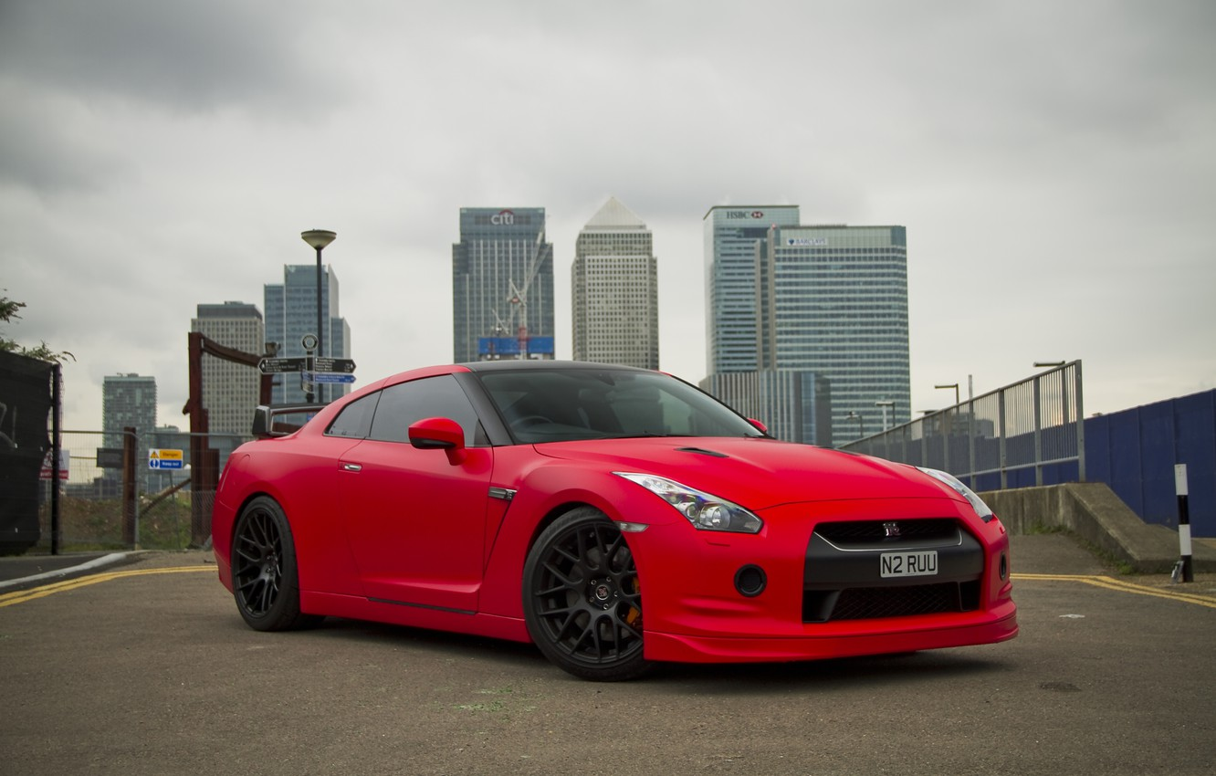 Photo wallpaper the sky, red, the city, building, nissan, red, front view, Nissan, gtr, gtr, r35