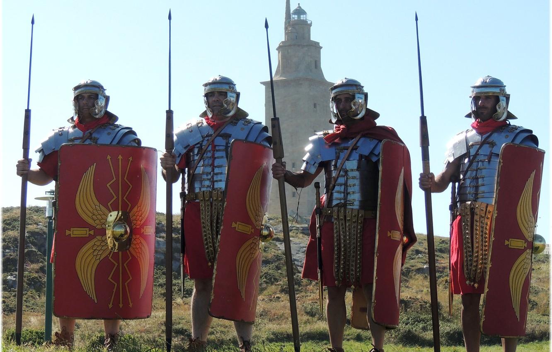 "Photo wallpaper grass, tower, armor, hill, swords, shields, Darts, hats, Roman legionaries, military-historical reconstruction, tunic, shoes ""kaliga"""