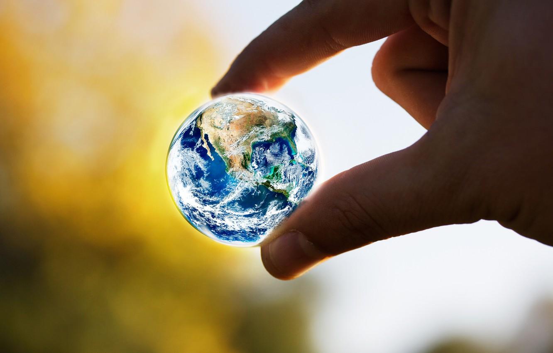 Photo wallpaper earth, hand, the globe