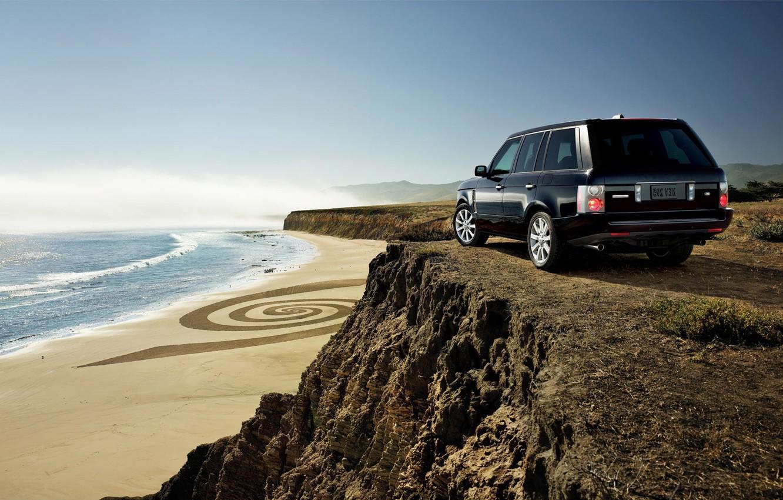 Photo wallpaper sand, sea, beach, the sky, grass, water, machine, the ocean, rocks, shore, height, cars, jeep, …