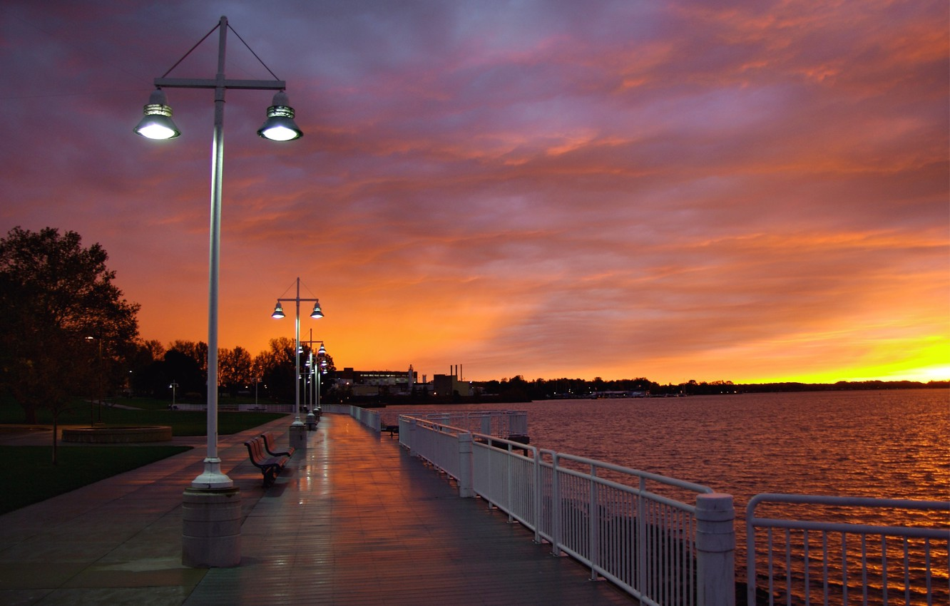 Photo wallpaper the sky, clouds, light, trees, sunset, clouds, river, the evening, The city, lights, benches, promenade