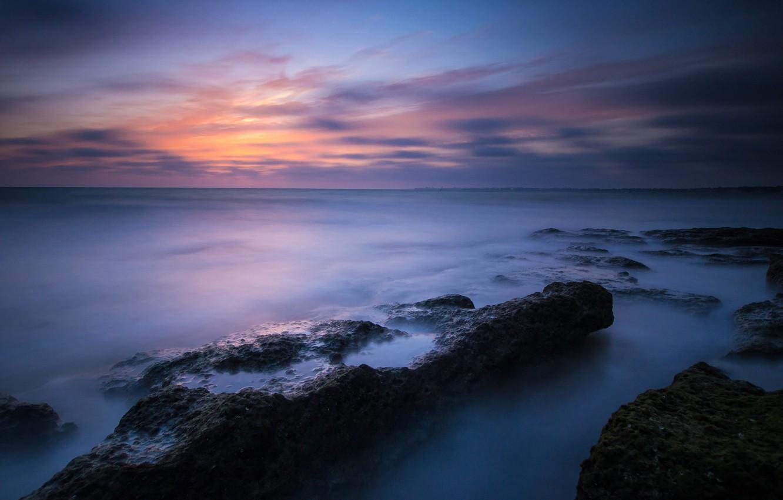 Photo wallpaper sea, the sky, clouds, sunset, stones, shore, the evening, calm, blue, Spain, Atlantic