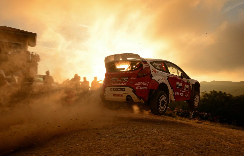 Photo wallpaper sunset, background, Ford, flight, car, WRC, Rally, Evgeny Novikov