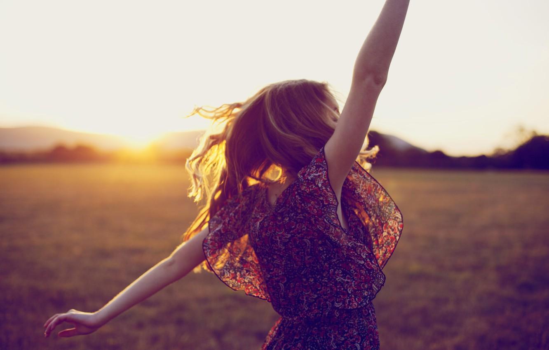 Photo wallpaper field, grass, the sun, joy, sunset, mountains, nature, pose, hair, Girl, blonde, girl, grass, happy, …