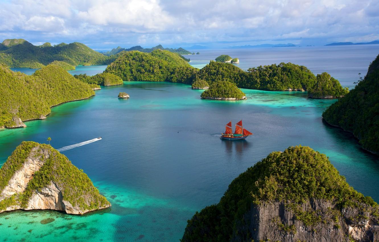 Photo wallpaper the sky, water, Islands, clouds, stones, rocks, vegetation, ship, sailboat, Indonesia, boat, Laguna
