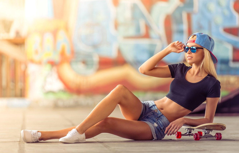 Photo wallpaper girl, pose, wall, graffiti, shorts, sneakers, figure, slim, glasses, t-shirt, blonde, cap, skate, Playground, bokeh, …