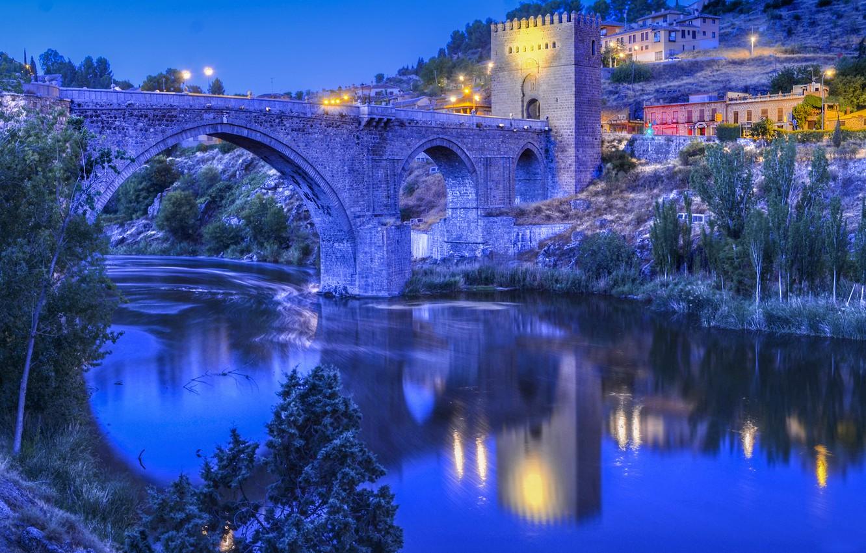 Photo wallpaper the sky, bridge, lights, river, tower, home, the evening, slope, Spain, Toledo, Toledo, Bridge of …