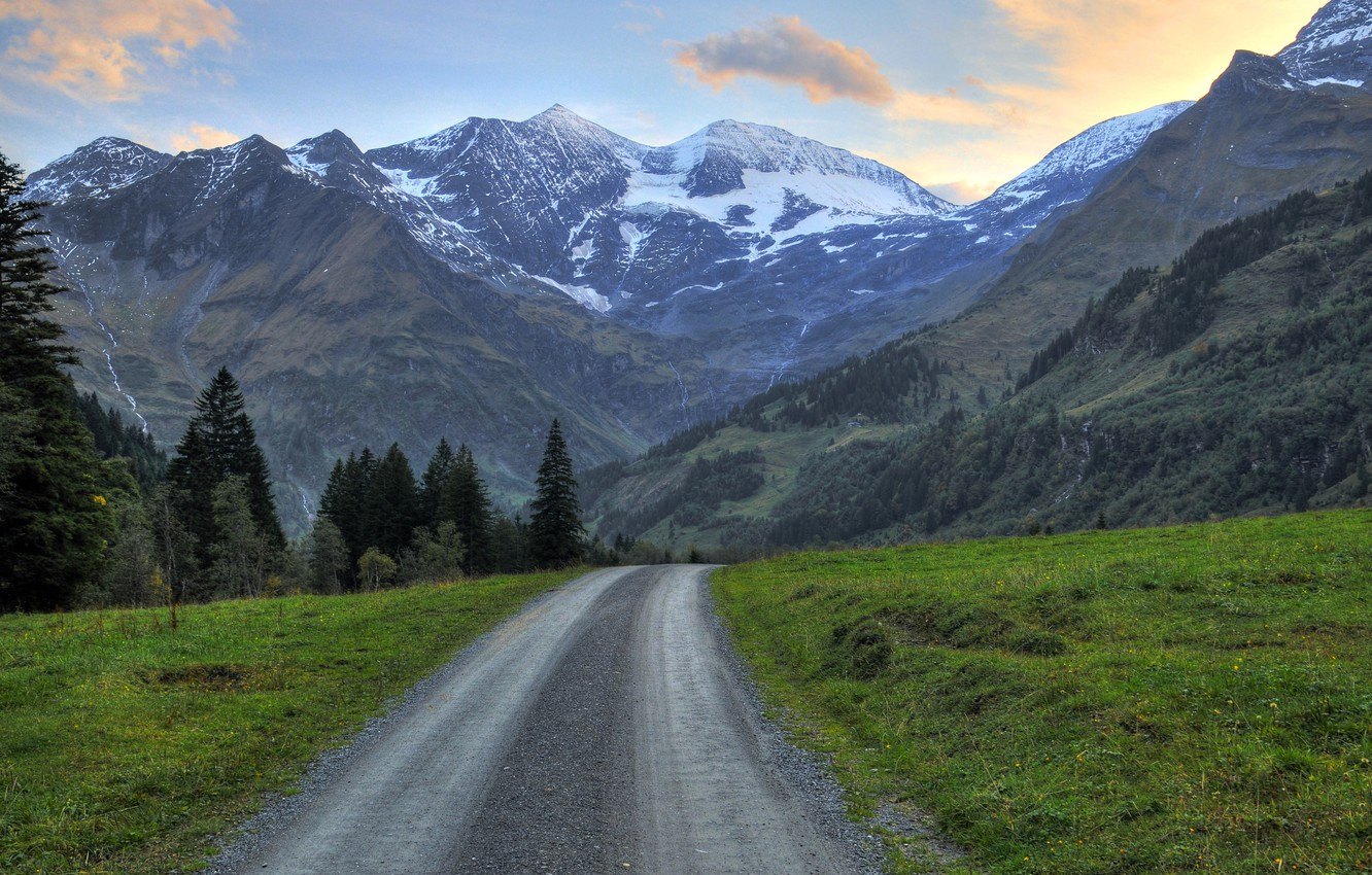 Photo wallpaper road, forest, grass, snow, trees, mountains