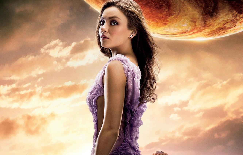 Photo wallpaper cinema, girl, sky, woman, clouds, movie, planet, Mila Kunis, film, pose, actress, building, Jupiter, earring, …