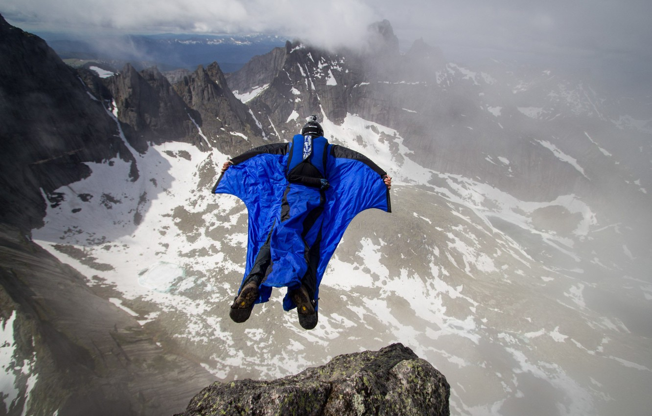 Photo wallpaper clouds, mountains, rocks, parachute, container, pilot, extreme sports, wingsuit, base jumping, beyser