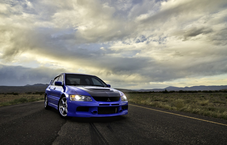 Photo wallpaper road, clouds, blue, front view, mitsubishi, blue, Mitsubishi, Lancer evolution, VIII, lancer evolution
