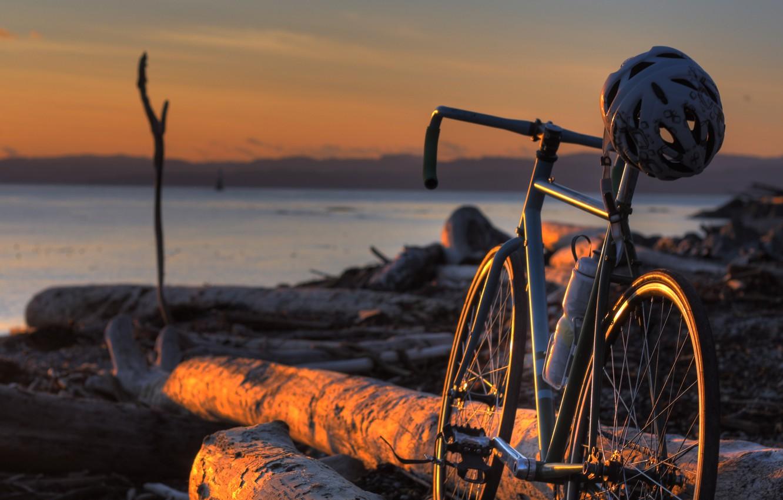 Photo wallpaper bike, shore, logs, helmet