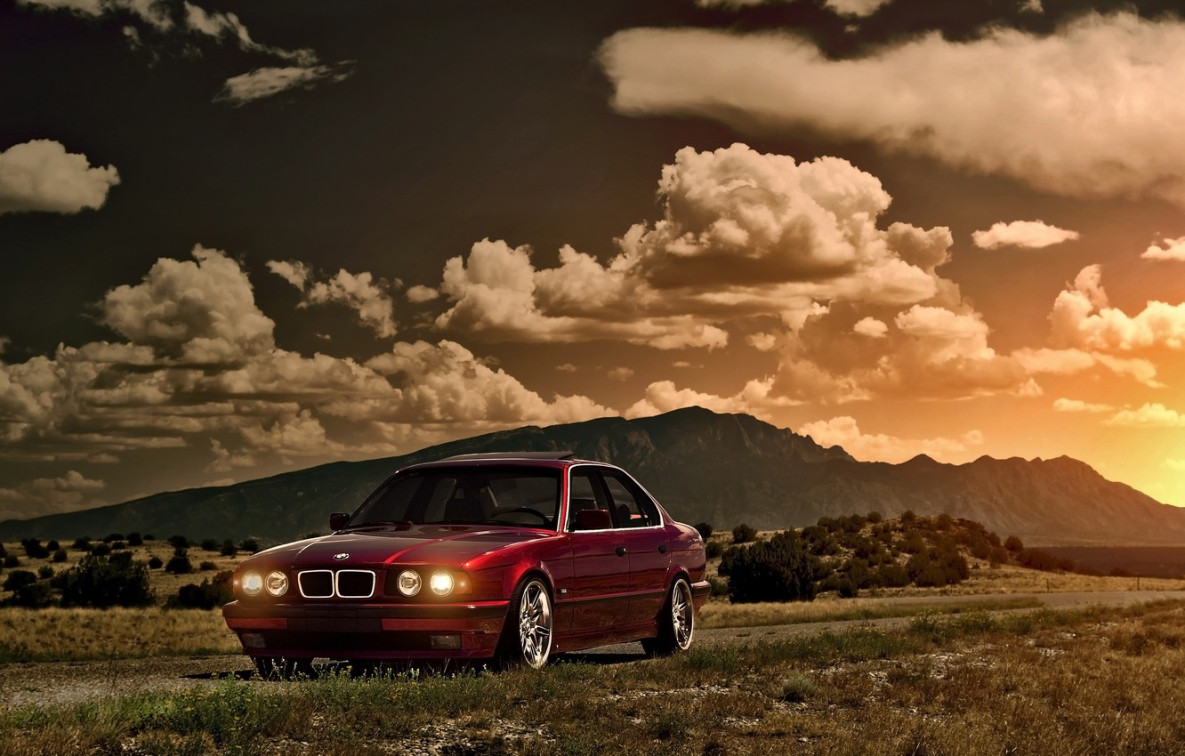 Photo wallpaper the sky, the sun, clouds, sunset, mountains, BMW, BMW, red, Blik, red, front, E34, 5 …
