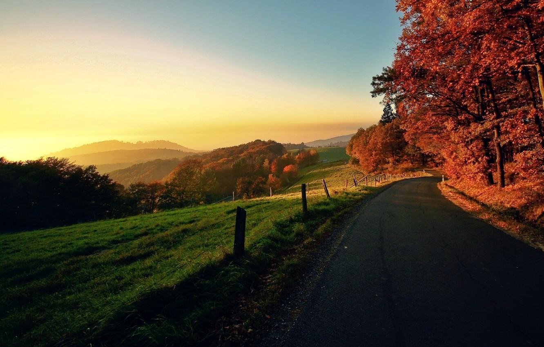Photo wallpaper road, autumn, the sky, the sun, trees, landscape, sunset, nature, sunrise, foliage, village, horizon, the …