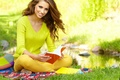 Picture brown hair, smile, book, plaid, girl, sitting, grass, pond