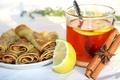 Picture lemon, tea, cinnamon, jam, pancakes, star anise