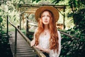 Picture greens, summer, girl, nature, foliage, hat, pendant, freckles, blouse, red, decoration, the bridge