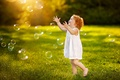Picture girl, curls, childhood, happiness, greens, bubbles, emotions, summer, joy, grass, dress